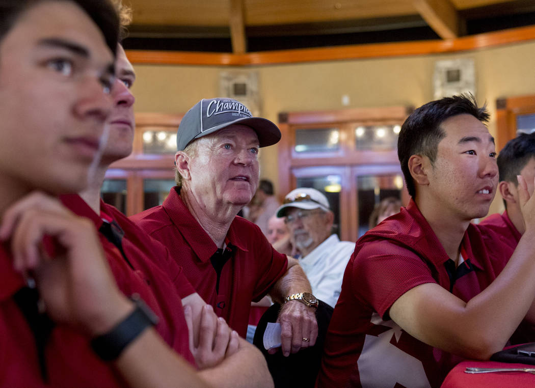UNLV men's golf head choach Dwaine Knight, center, waits with his team to hear where they will ...