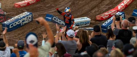Red plate points leader Cooper Webb (2) greets the fans before the featured 450 SX class race a ...