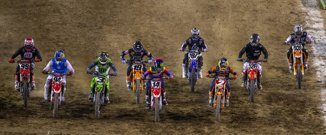 Red plate points leader Cooper Webb (2) starts out strong during the featured 450 SX class race ...