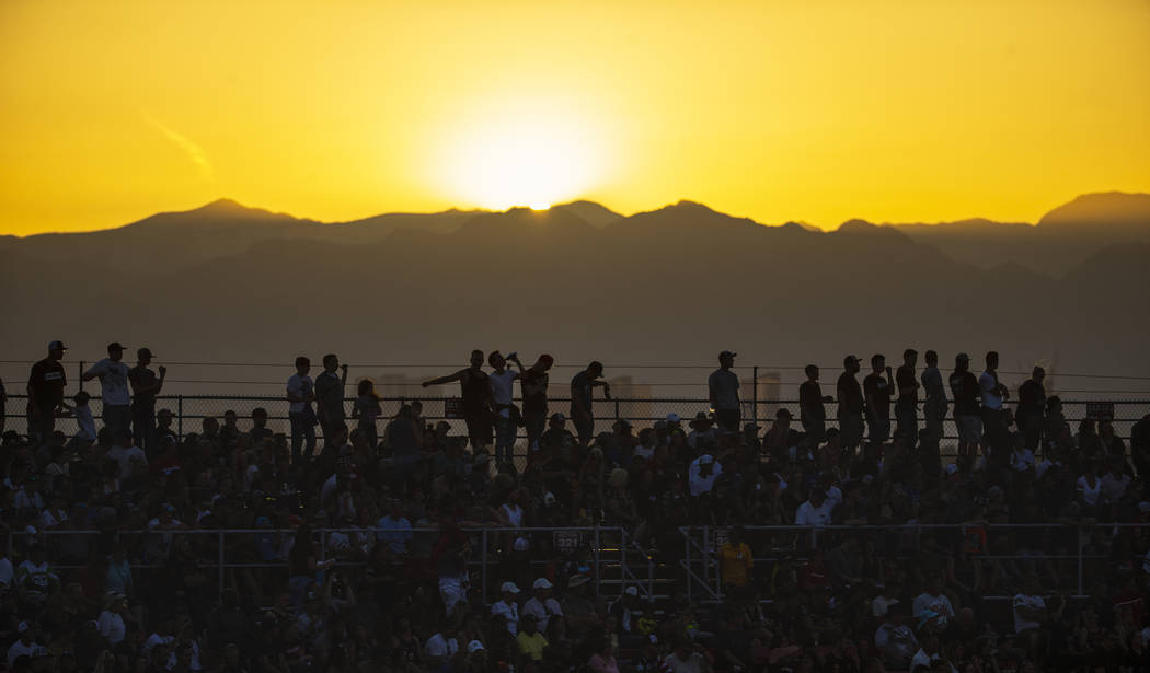 The sun sets behind fans during the featured 450 SX class race at Sam Boyd Stadium on Saturday, ...