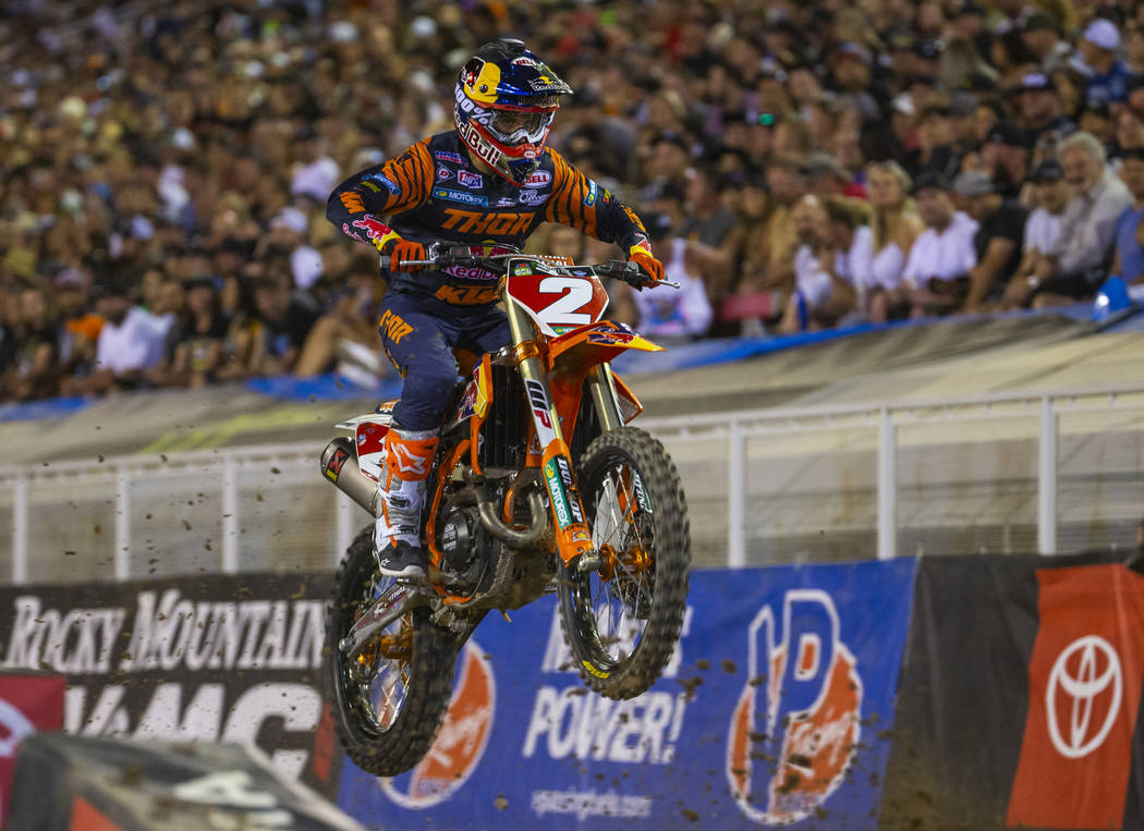 Red plate points leader Cooper Webb (2) takes a big jump as he leads the pack during the featur ...
