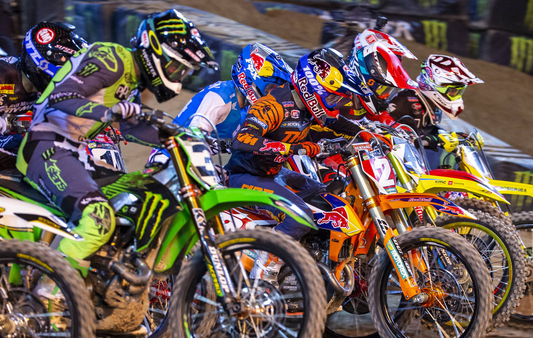 Red plate points leader Cooper Webb (2) takes off at the start during the featured 450 SX class ...