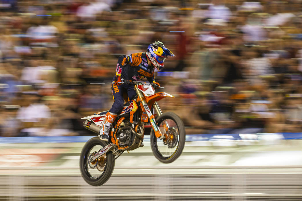 Red plate points leader Cooper Webb (2) soars past the crowd during the featured 450 SX class f ...