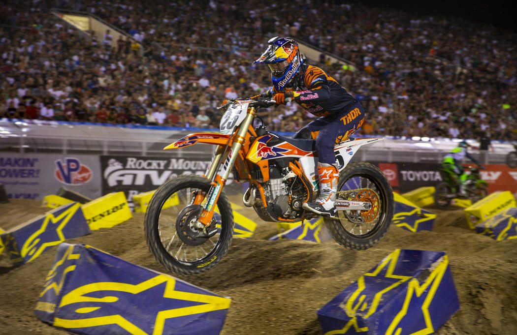 Red plate points leader Cooper Webb (2) maneuvers along the track during the featured 450 SX cl ...
