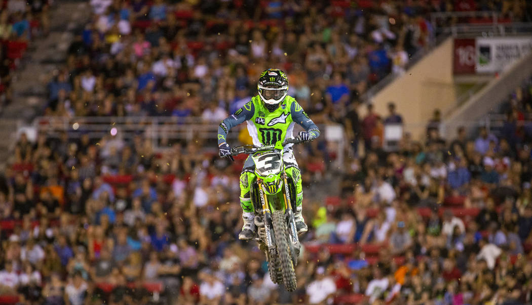Eventual race winner Eli Tomac (3) soars above the track during the featured 450 SX class final ...