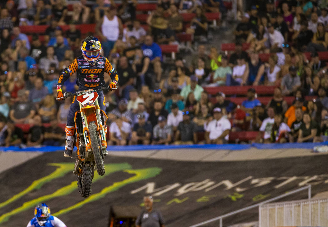 Red plate points leader Cooper Webb (2) catches some air during the featured 450 SX class final ...