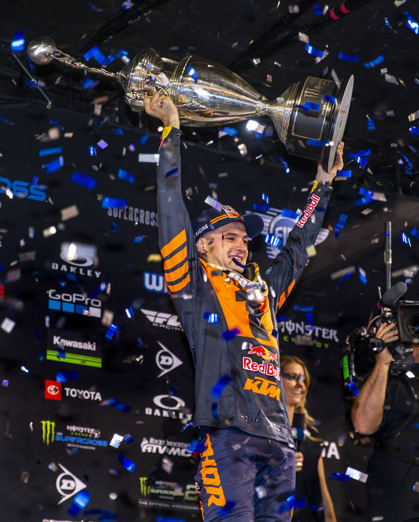 Red plate points leader Cooper Webb (2) celebrates his championship by hoisting the trophy foll ...