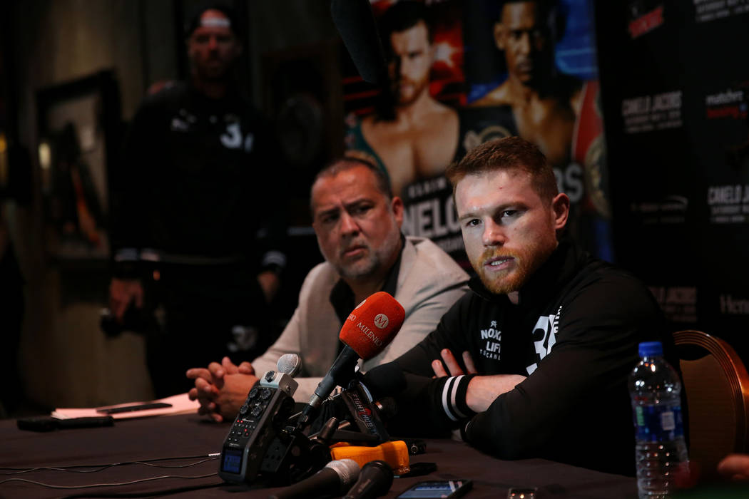 """Saul """"Canelo"""" Alvarez, right, speaks to reporters during a press conference at the MG ..."""