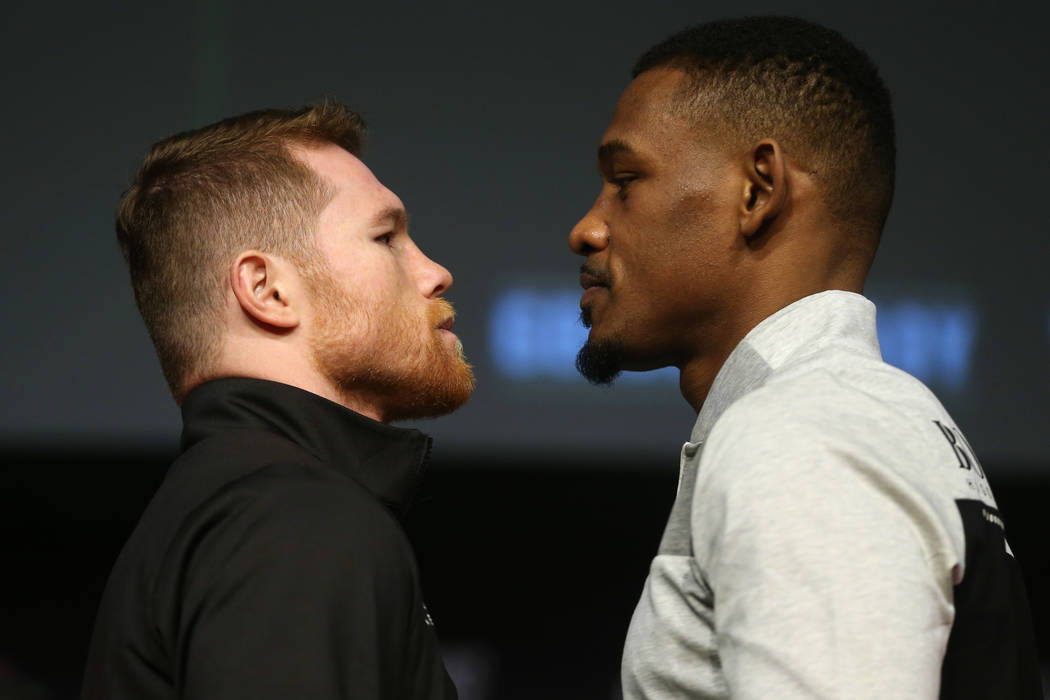 """Saul """"Canelo"""" Alvarez, left, and Daniel Jacobs, pose during a press conference at the ..."""
