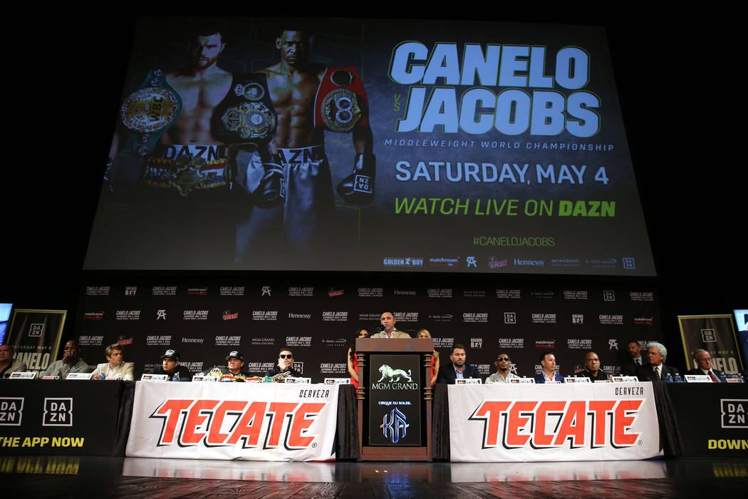 Boxing promoter Oscar De La Hoya, center, speaks during a press conference for the upcoming tit ...
