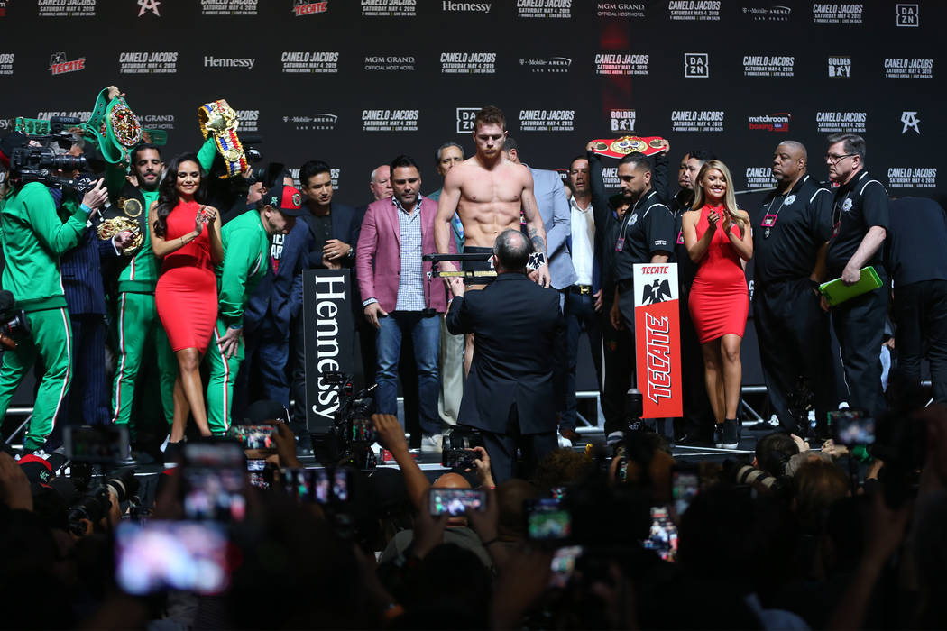 """Saul """"Canelo"""" Alvarez stands on the scale for his weigh-in at T-Mobile Arena in Las V ..."""
