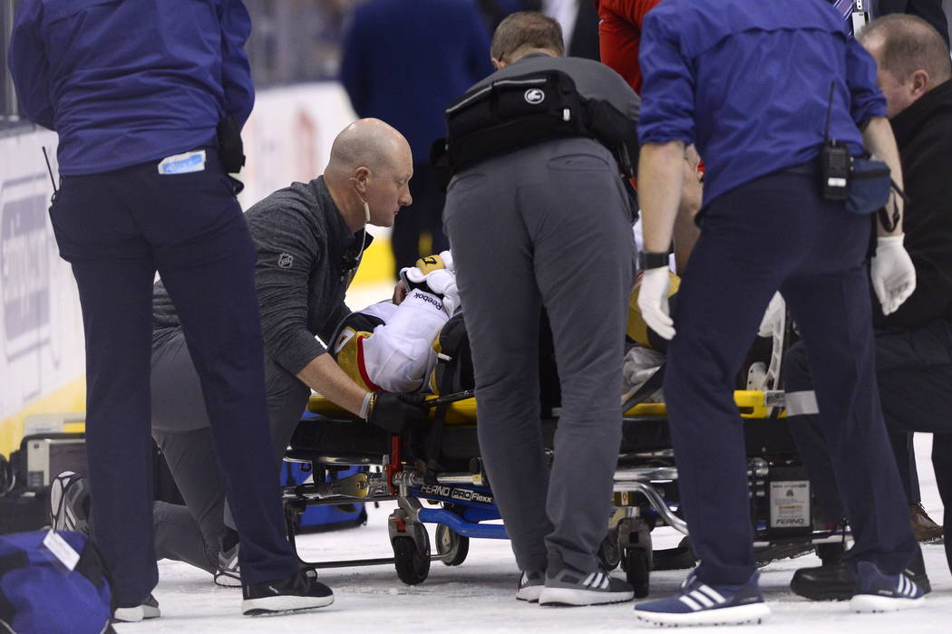 Vegas Golden Knights center Erik Haula (56) is taken off the ice on a stretcher after taking a ...