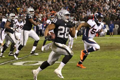 Oakland Raiders running back Doug Martin (28) runs with the football as Denver Broncos inside l ...