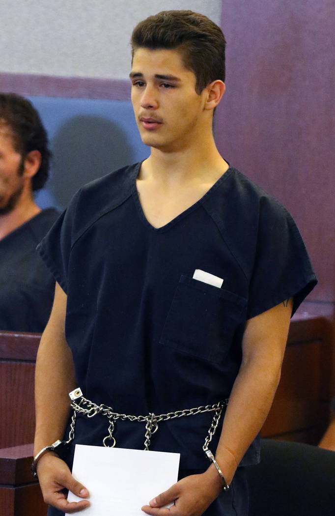 Anthony Okelberry, who is charged with fatally shooting a security guard, appears in court at t ...