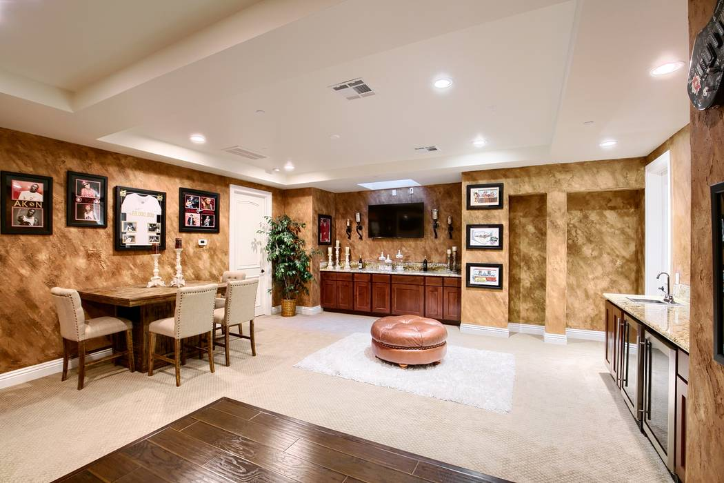 The basement has a game room, bar and theater. (Signature Real Estate Group)