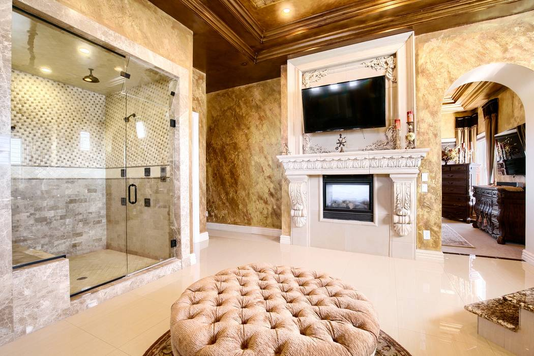 The master bath features a fireplace. (Signature Real Estate Group)