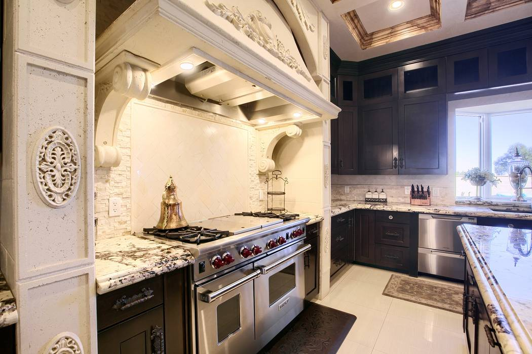 The kitchen is equipped with upgraded appliances. (Signature Real Estate Group)