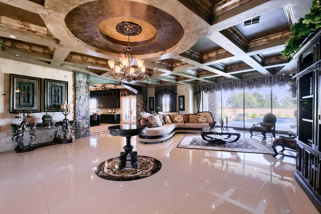 The living room has a traditional style. (Signature Real Estate Group)