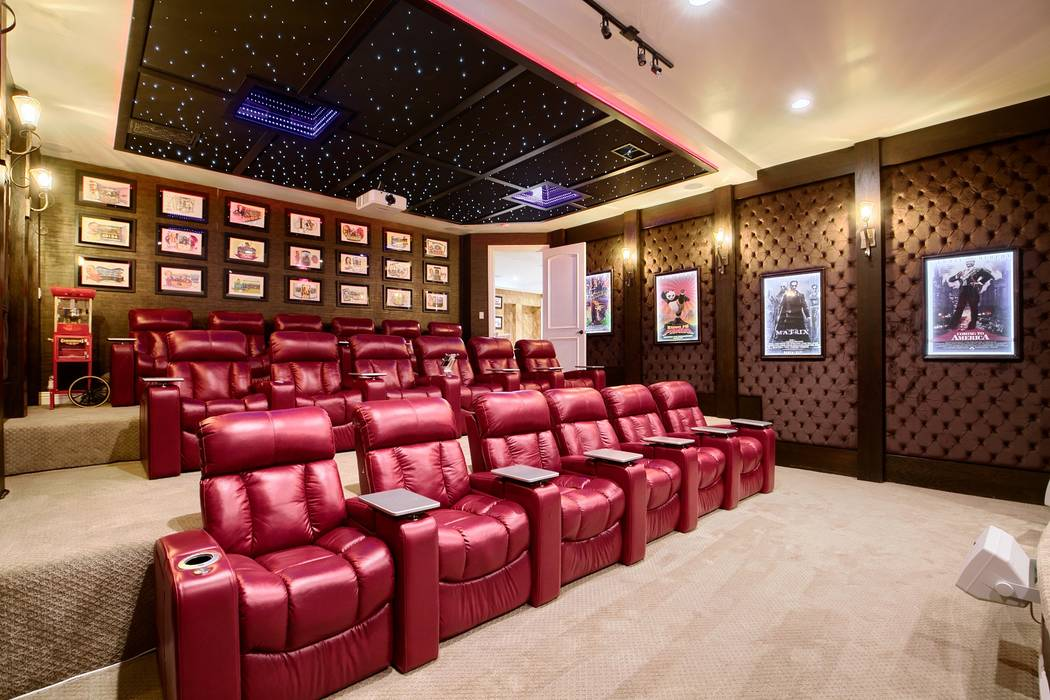 The basement houses a large home move theater. (Signature Real Estate Group)