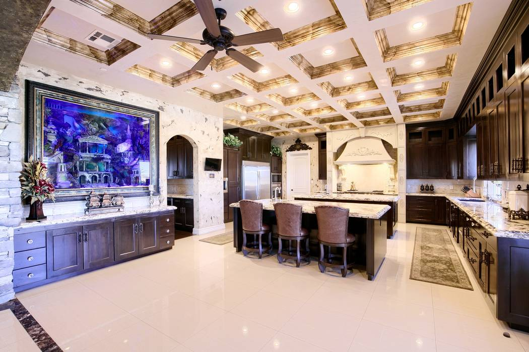 The kitchen features a custom 700-gallon aquarium with 25 sea creatures, including angelfish, t ...
