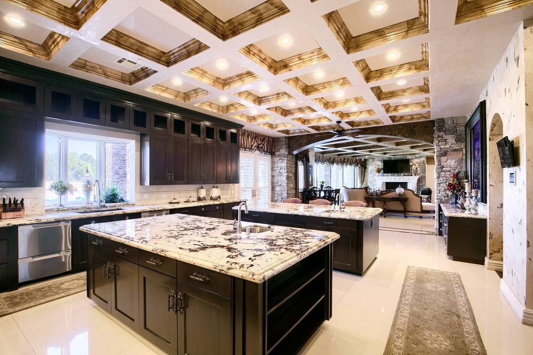 The kitchen has two islands. One for food prep and the other for social gatherings. (Signature ...