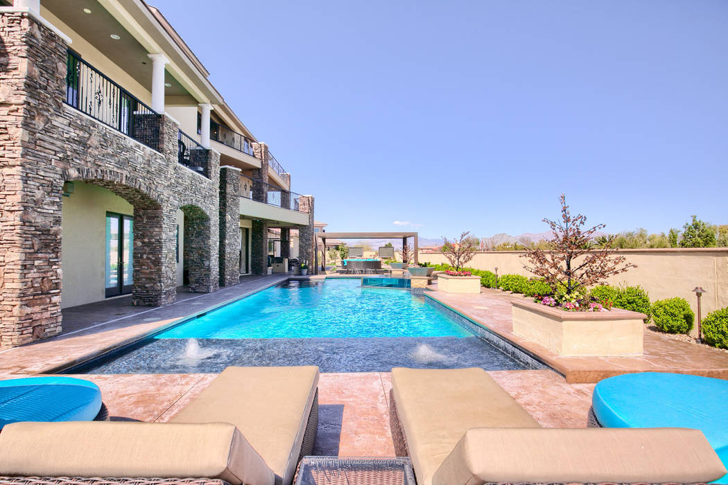 The four-story home features a 60-foot pool. (Signature Real Estate Group)