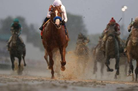 Mike Smith rides Justify to victory during the 144th running of the Kentucky Derby horse race a ...