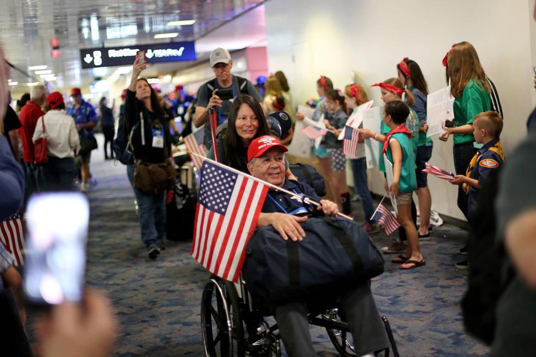 U.S. Air Force veteran Leo Mainwal, with guardian Brenda Mainwal, greets people as they welcome ...
