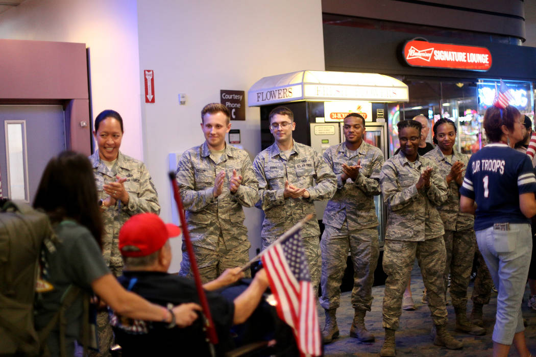 Soldiers welcome back veterans from a trip to visit the national war memorials in Washington D. ...