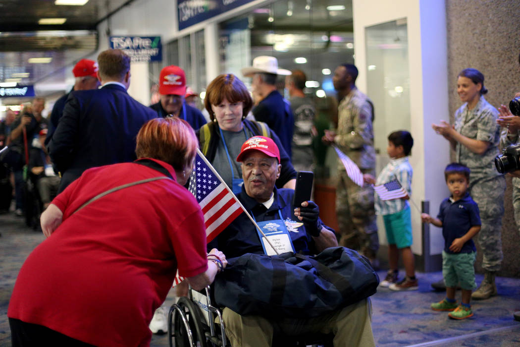 """Veteran Hylas """"Hy"""" Strange Jr. greets people as they welcome him back from a trip to ..."""