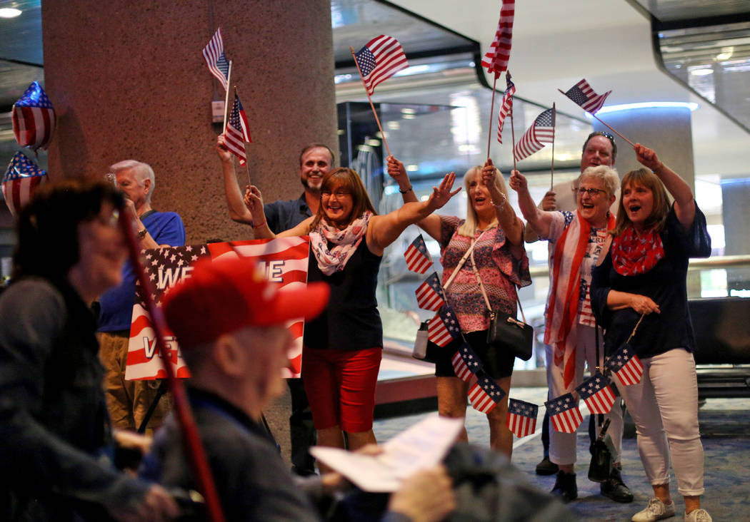 Supporters greet veterans upon their return from a trip to visit the national war memorials in ...