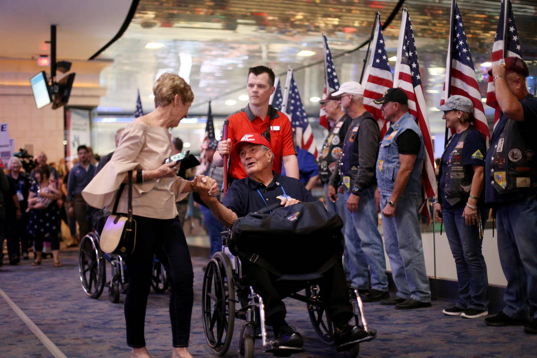 Gayle Albright greets her husband, veteran Gene Albright, upon his return from a trip to visit ...
