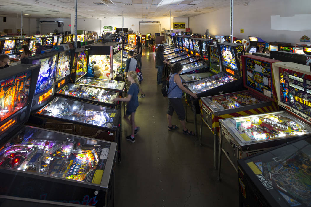 Patrons visit the Pinball Hall of Fame located at 1610 E. Tropicana Avenue in Las Vegas on Satu ...