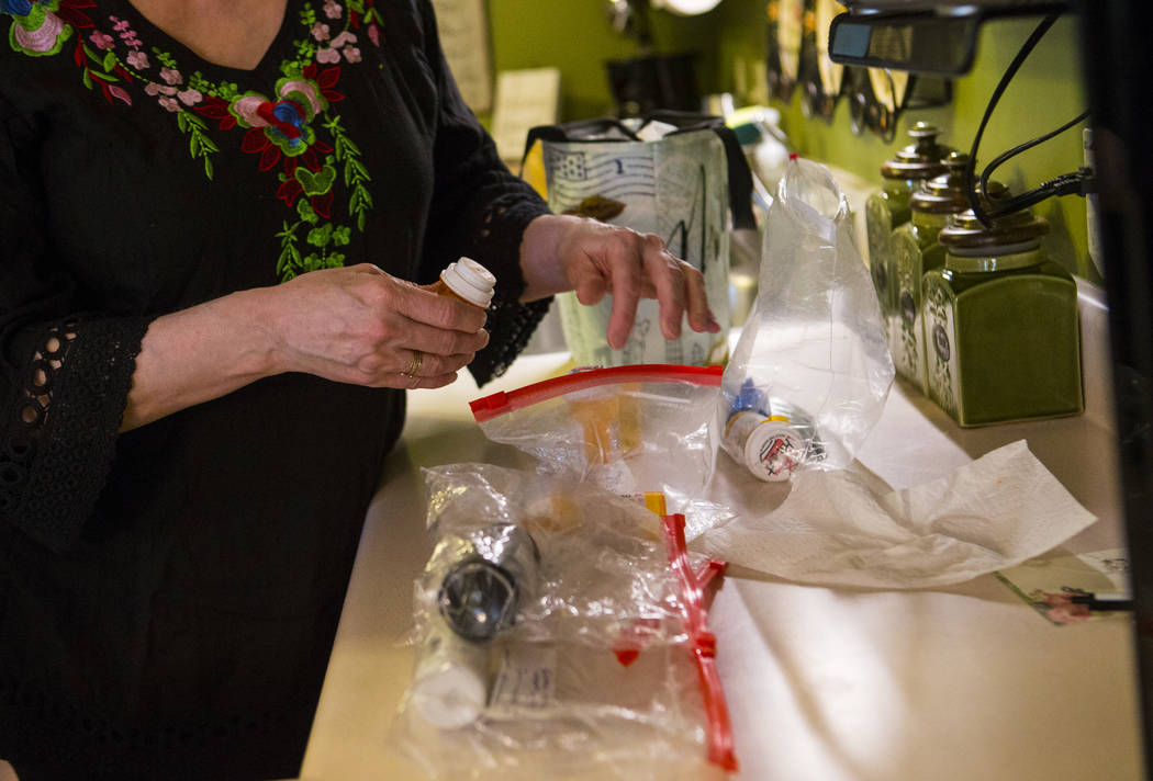 Kay McClure prepares medication for her son, Grayson McClure, at their home in Collierville, Te ...