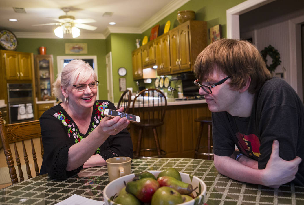 Kay McClure, left, and Grayson McClure talk on the phone with Dr. Bruce Fong, Grayson's Reno-ba ...