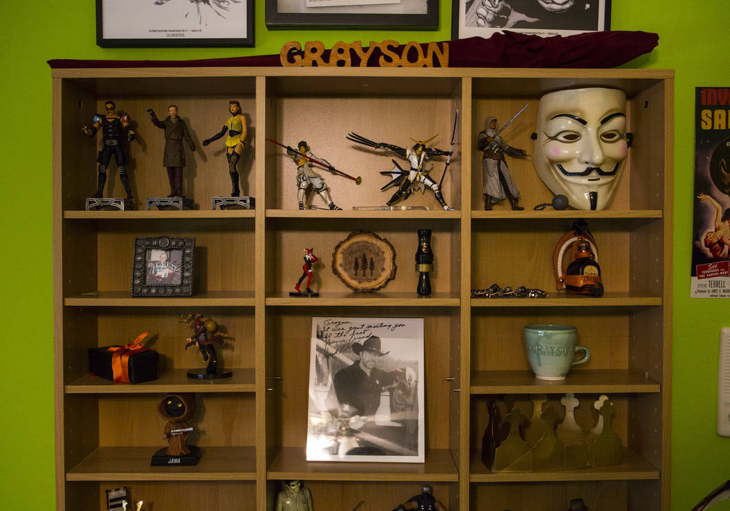 Personal items in the bedroom of Grayson McClure, including a signed message and picture from a ...