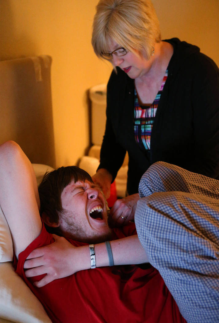Kay McClure administers medicine to her son Grayson in their Reno home on Monday, May 9, 2016. ...