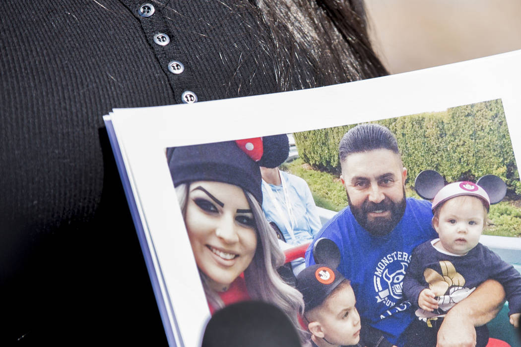 Julie Campos holds a photo of her husband, Luis, and their children at the Metropolitan Police ...