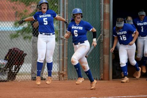 Basic players, including Jordyn Ebert (5) and Angela Santillanes (6) celebrate a home run by Si ...