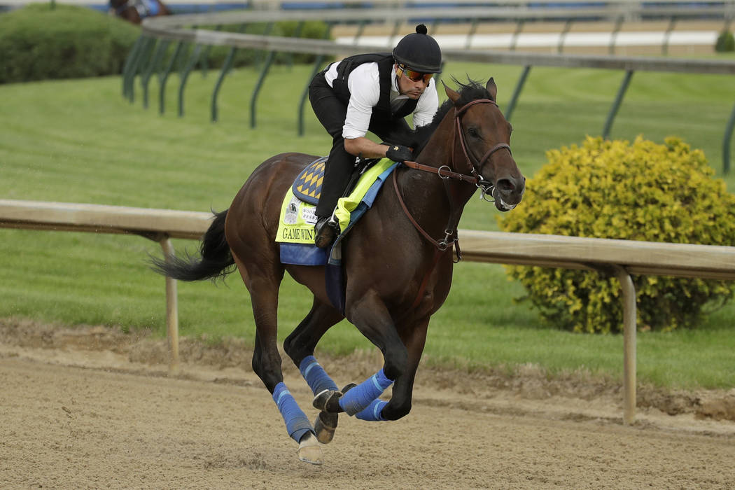 Kentucky Derby entrant Game Winner is ridden during a workout at Churchill Downs Wednesday, May ...