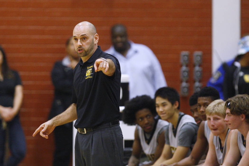 Clark head coach Chad Beeten directs his players against Mojave on Tuesday. Clark won 52-47 in ...