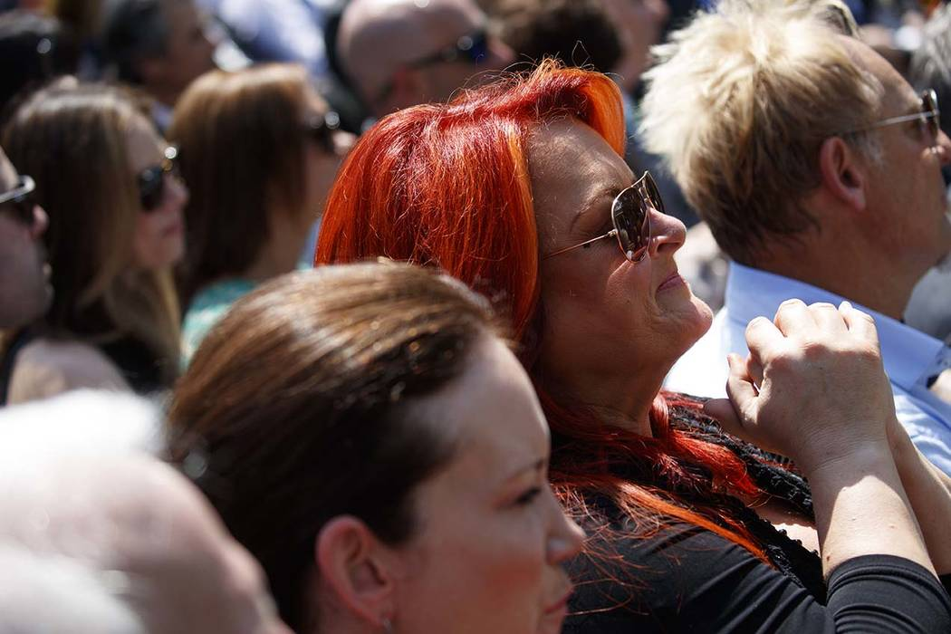 Musician Wynonna Judd listens as President Donald Trump speaks during a National Day of Prayer ...