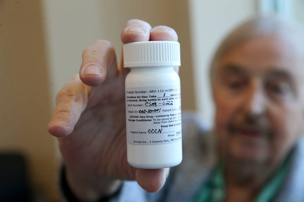 Anthony Brasich, 71, of Las Vegas shows his pill bottle with employee ID 001 while waiting for ...