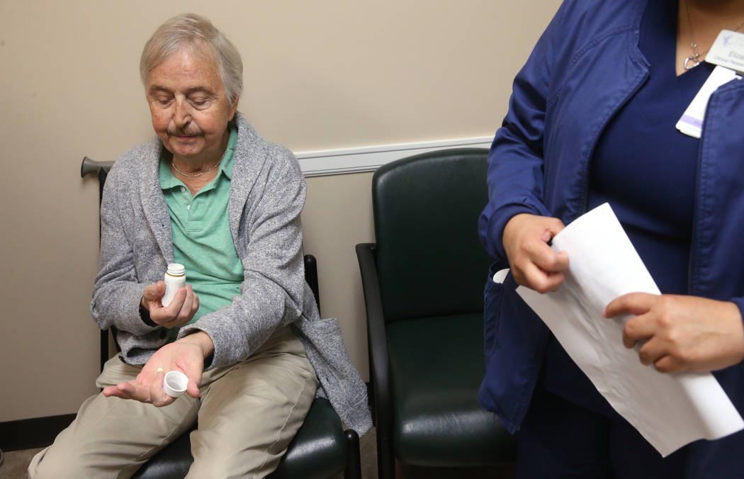 Anthony Brasich, 71, of Las Vegas prepares to take his dosage of a new cancer treatment at Comp ...