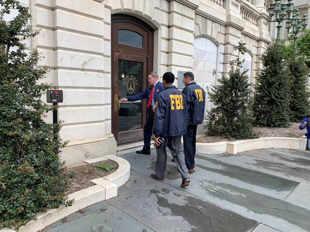 Federal Bureau of Investigation and Internal Revenue Service agents enter City Hall in Baltimor ...