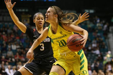 Oregon Ducks guard Sabrina Ionescu (20) looks to pass the ball while being guarded by Stanford ...