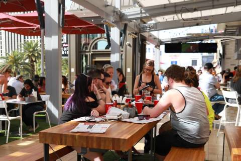 Patrons enjoy drinks at Beer Park at Paris Casino in Las Vegas on Sunday, April 1, 2018. (Andre ...