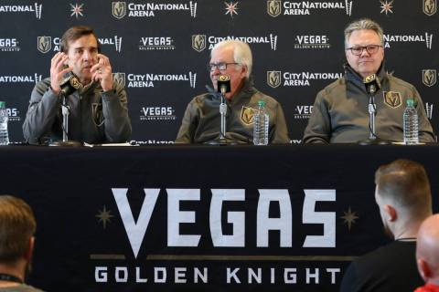 Golden Knights owner Bill Foley, center, and Kelly McCrimmon, the new General Manager, listen a ...