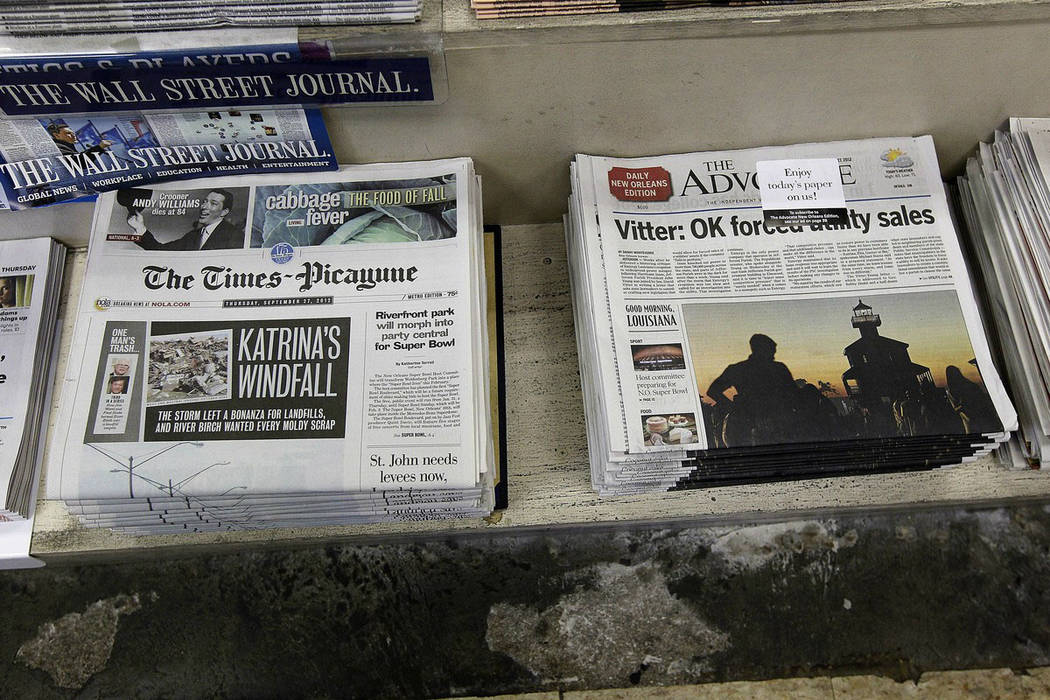 Free introductory copies of the Baton Rouge Advocate's new New Orleans edition, right, are seen ...