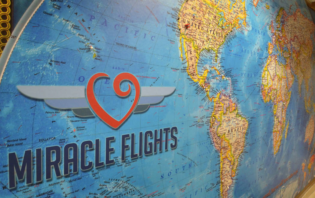 A map with pins showing locations Miracle Flights has traveled to is shown in the organization& ...
